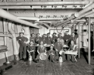 1896. U.S.S. Maine -- berth deck cooks. And their feline mascot